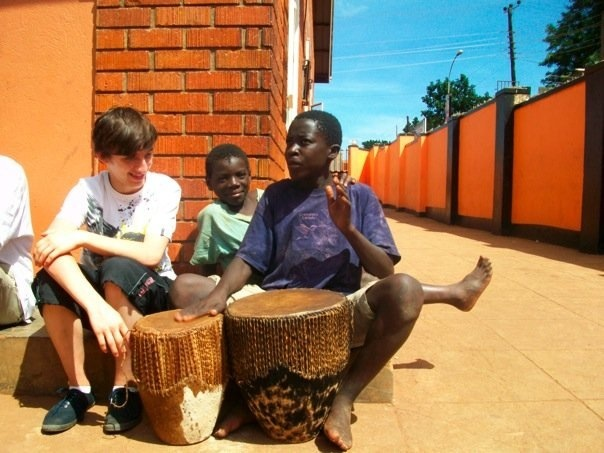 Geoff drumming on a visit to Tigers project after recovery!